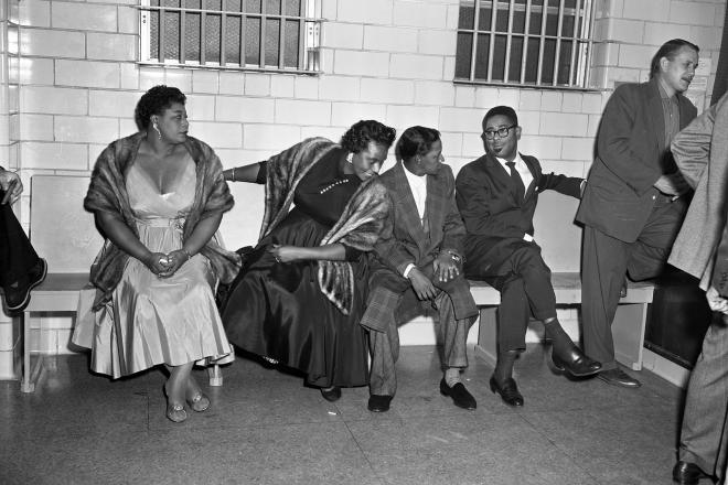 Jazz musicians after being arrested during a concert. Seated, from left: Ella Fitzgerald, Georgiana Henry (Fitzgerald's assistant), Illinois Jacquet, and Dizzy Gillespie. RGD0006N-1955-0764-1, Houston Public Library, Houston Metropolitan Research Center.