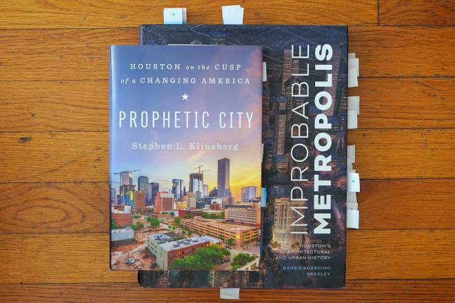 "An editor's copies of ""Prophetic City"" and ""Improbable Metropolis."""