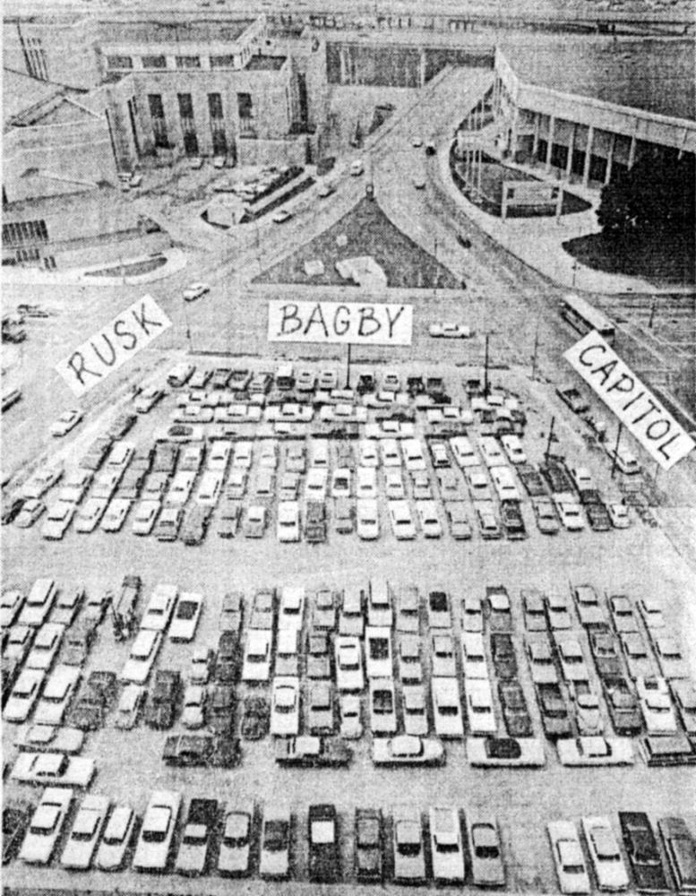 The parking lot that became Little Tranquility Park between Rusk Street and Capitol Street.
