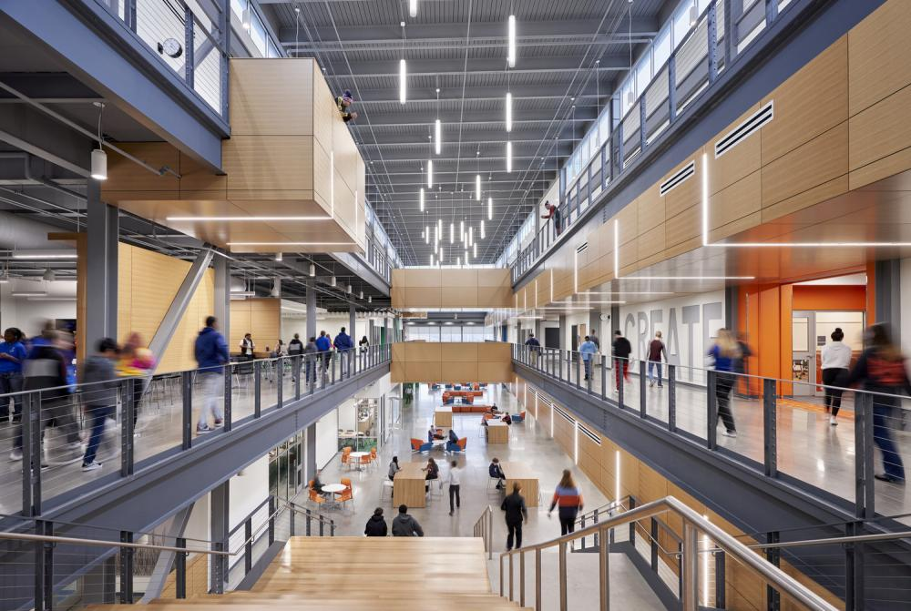 The central circulation spine of Capital City High School offers natural daylight, connectivity across floors, and a variety of small group learning opportunities. Capital City High School, 2020. Photo ©Michael Robinson, courtesy DLR Group.