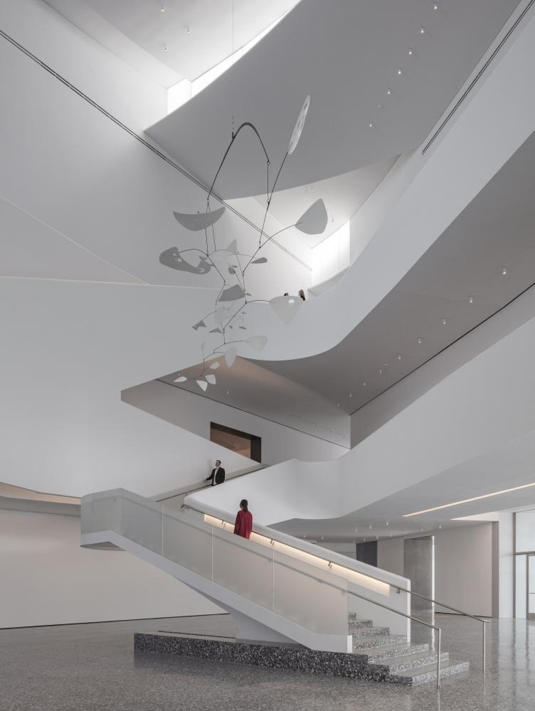 The Nancy and Rich Kinder Building at the Museum of Fine Arts, Houston, atrium, with Alexander Calder's International Mobile, 1949. © Richard Barnes, courtesy of the Museum of Fine Arts, Houston.