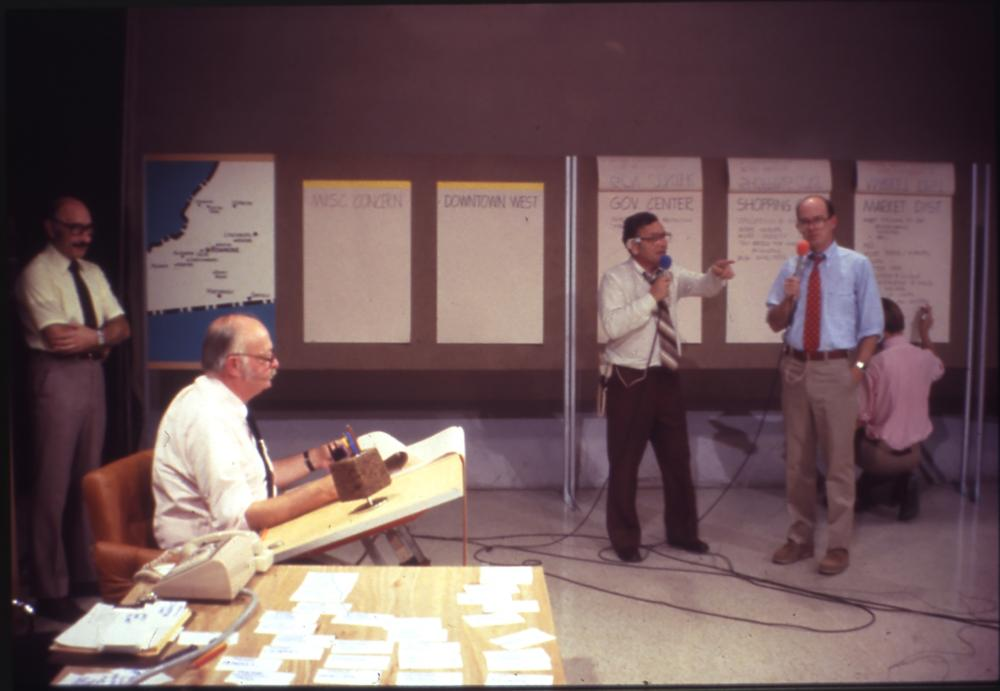Charles Moore (seated) drafting live during a television broadcast of Roanoke Design '79. 1979. Design-A-Thon. Centerbrook Architects and Planners Records. Manuscripts and Archives, Yale University Library © Centerbrook Architects and Planners.