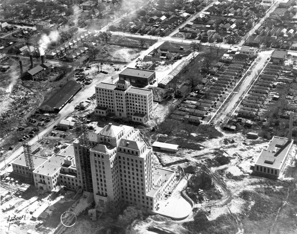 Figure 9. Aerial photograph of the Jefferson Davis Hospital just after completion. The monumental hospital contrasts with the surrounding single-story, shotgun housing. RGD0005-f1031, Houston Public Library, Houston Metropolitan Research Center.