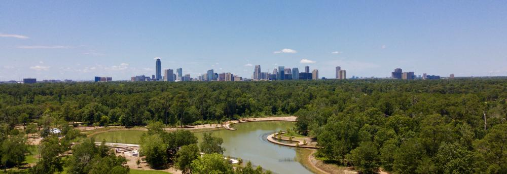 Hines Lake with Uptown background. Courtesy Memorial Park Conservancy.