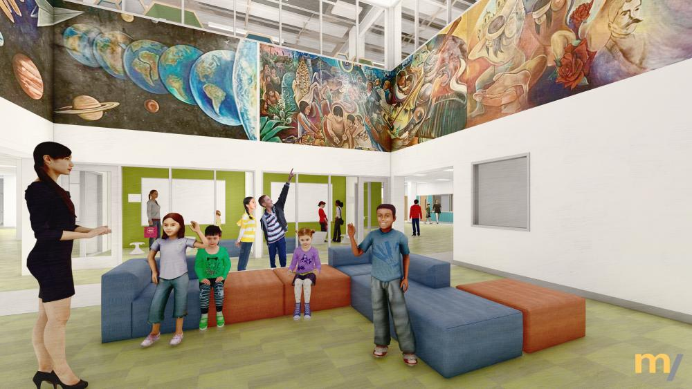 The celebrated mural anchors the school through a double height space that connects the library on the second floor with an open collaboration area on the first floor. Image courtesy McKinney York Architects.