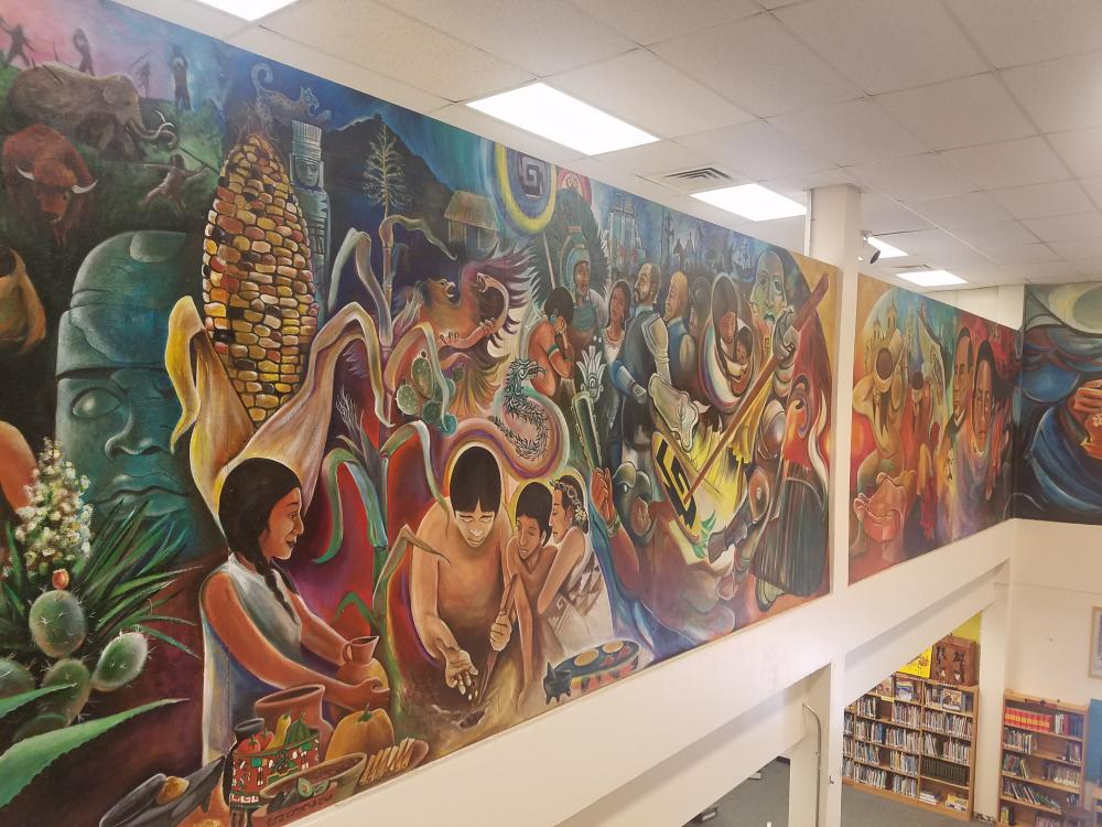 """""""A Children's Mural"""" by Raul Valdez and Sánchez Elementary students in existing school library. Image courtesy McKissack & McKissack."""