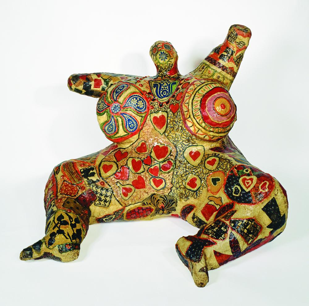 """Niki de Saint Phalle, """"Seated Nana,"""" 1965. Painted polyester resin, fabric, wire mesh, and collage, 39 3/8 × 55 1/8 × 55 1/8 in. Private collection, Courtesy Niki Charitable Art Foundation, Santee © Niki Charitable Art Foundation. Photo: L. Condominas."""