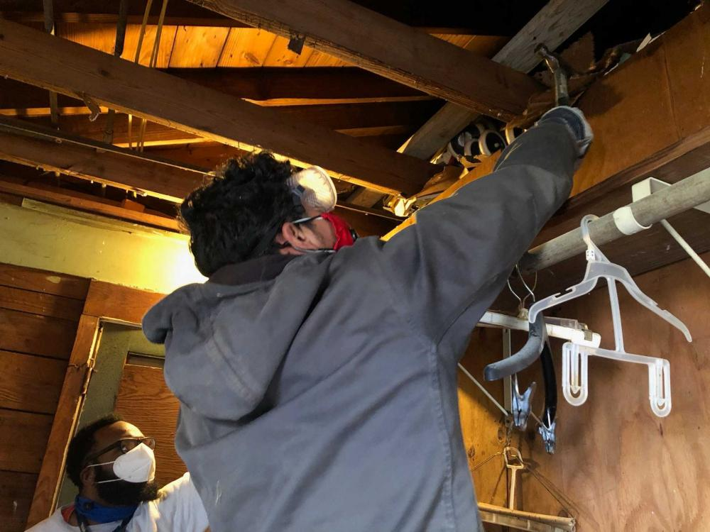 West Street Recovery staffers Felix Kapoor and Andrew Barley taking down damaged ceiling sheetrock. Courtesy West Street Recovery.