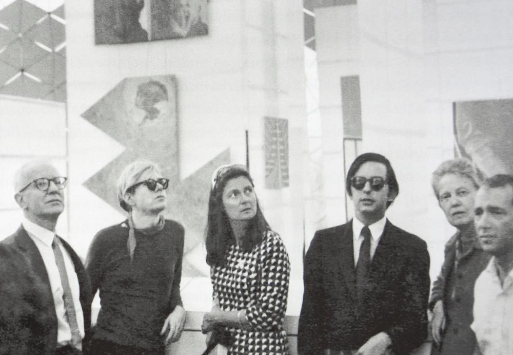 "John de Menil, Andy Warhol, Simone Swan, Fred Hughes, Dominique de Menil, and Howard Barnstone in Buckminster Fuller's US pavilion for Expo 67, Montreal. 1967. As reproduced in ""Making Houston Modern."""