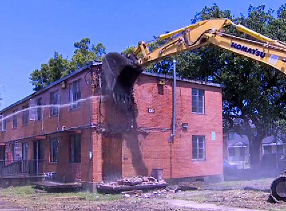 2009 demolition of housing damaged by Hurricane Ike in 2008. Image via Swamplot.