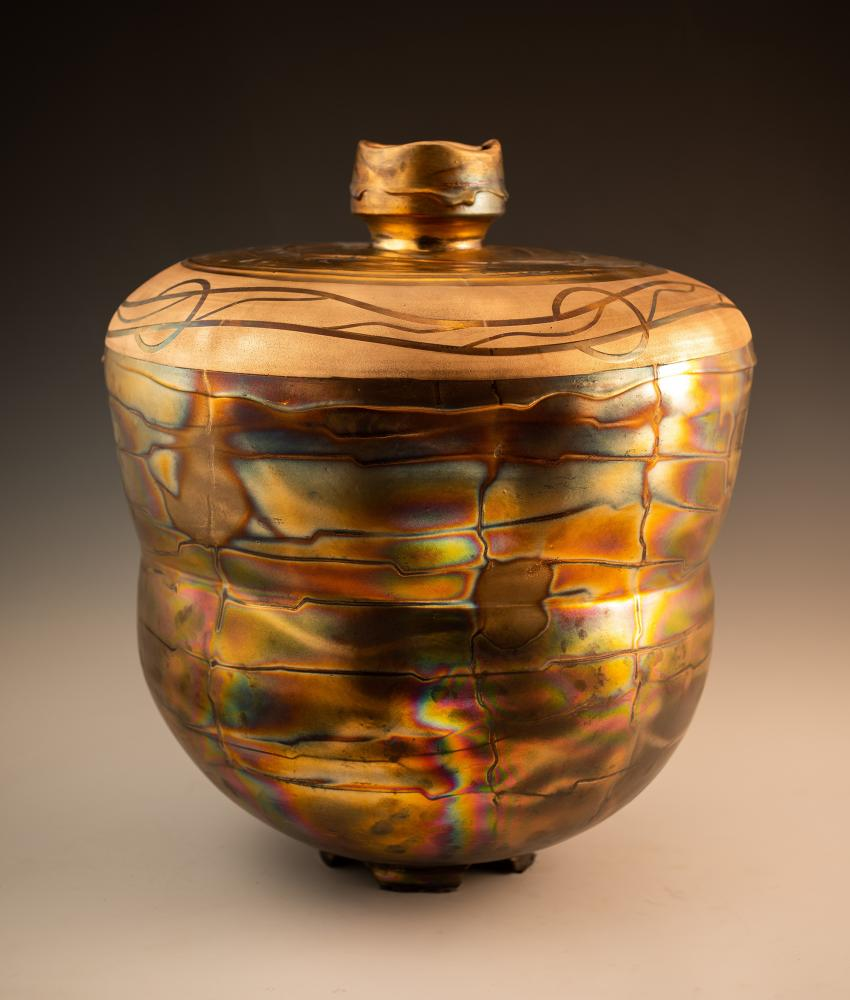 """James C. Watkins, """"Fumed # 2- Bottle Form,"""" 2020. Fumed gold luster. 26 x 22 inches. Photo by artist. Courtesy Houston Center for Contemporary Craft."""