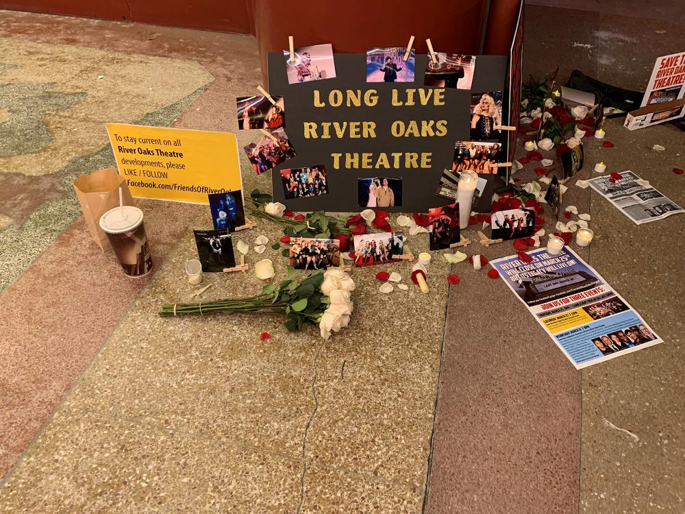 A makeshift memorial during the candlelit gathering in front of the River Oaks Theatre on March 25, 2021. Photo by David Welling.